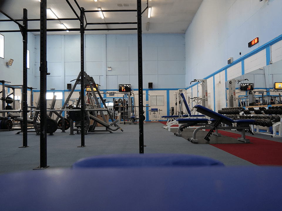 Gym floor with gym equipment at Vida Health and Fitness